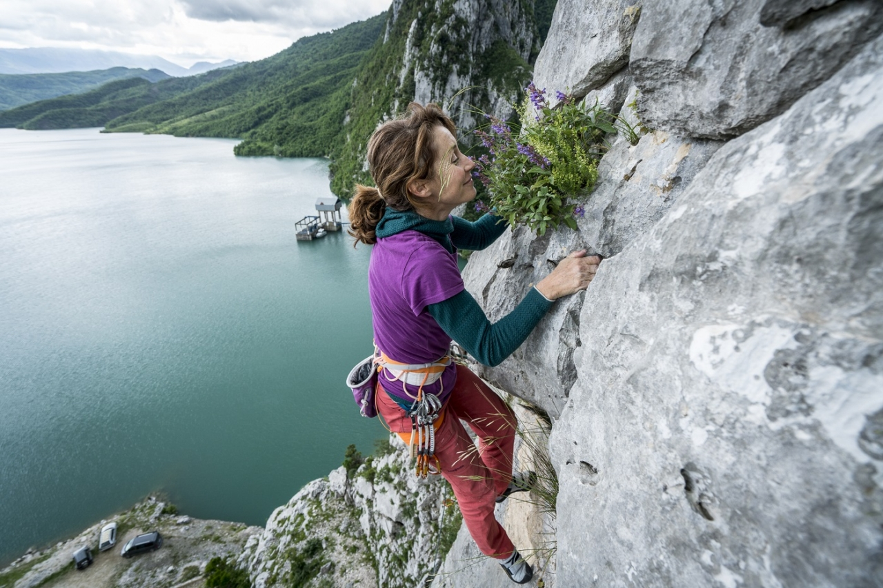 """Stéphanie Bodet takes time to """"smell the roses"""" at Bovilla. Photo: Mikey Schaefer"""
