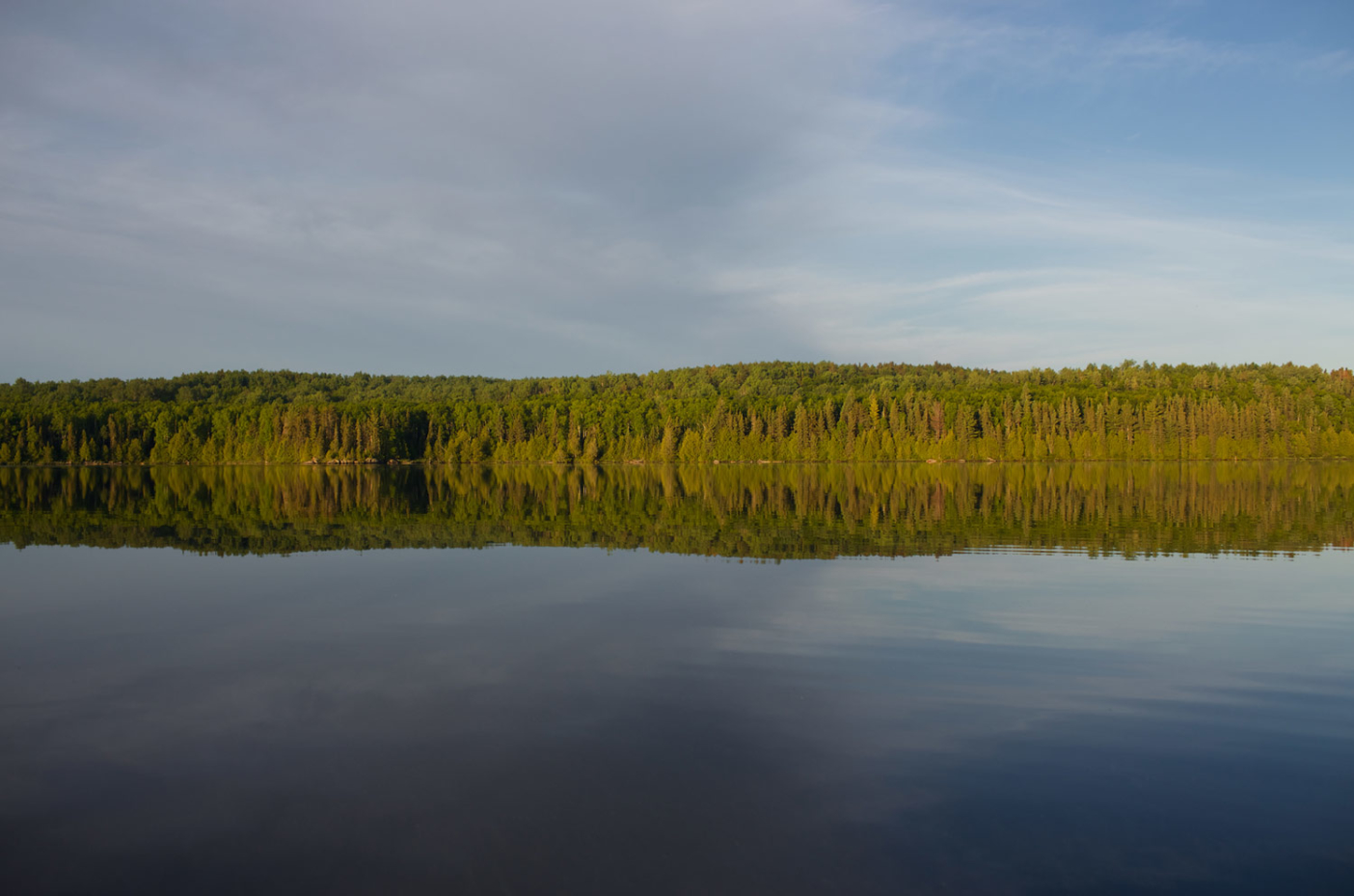 Solitude and stillness, as found on one of the thousands of pristine lakes that make up the 1.1-million-acre Boundary Waters Canoe Area Wilderness in northern Minnesota. Photo: Nate Ptacek