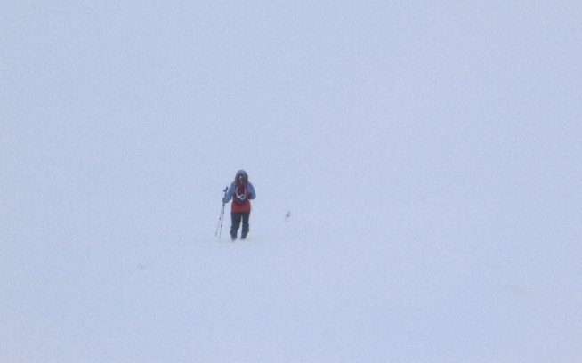 Simon navigating toward the block of rock atop the Cairn Gorm plateau. Photo: Kelly Cordes