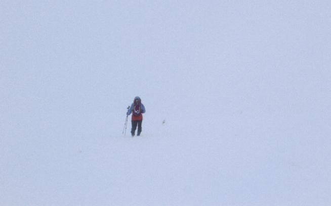 Simon navigating toward the block of rock atop the Cairn Gorm plateau. Photo: Kelly Cordes