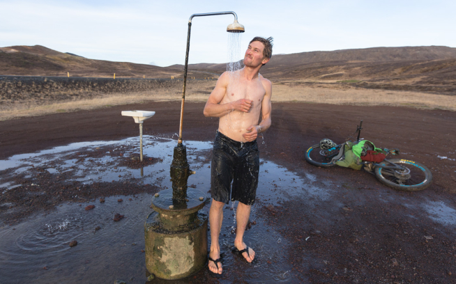 After a finger-numbing ride through the highlands, Carston can't quite believe his luck as he warms up under one of Iceland's most luxurious natural amenities—unlimited hot water from underground geothermal fields. Photo: Mary McIntyre
