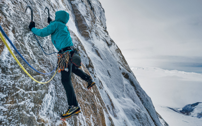Lean and mean. Using only tiny granite edges and small blobs of ice, Chris Mutzel finds the first pitch of Exocet on Aguja Standhardt to be run out, rime-covered and extra-heady. Argentine Patagonia. Photo: Austin Siadak