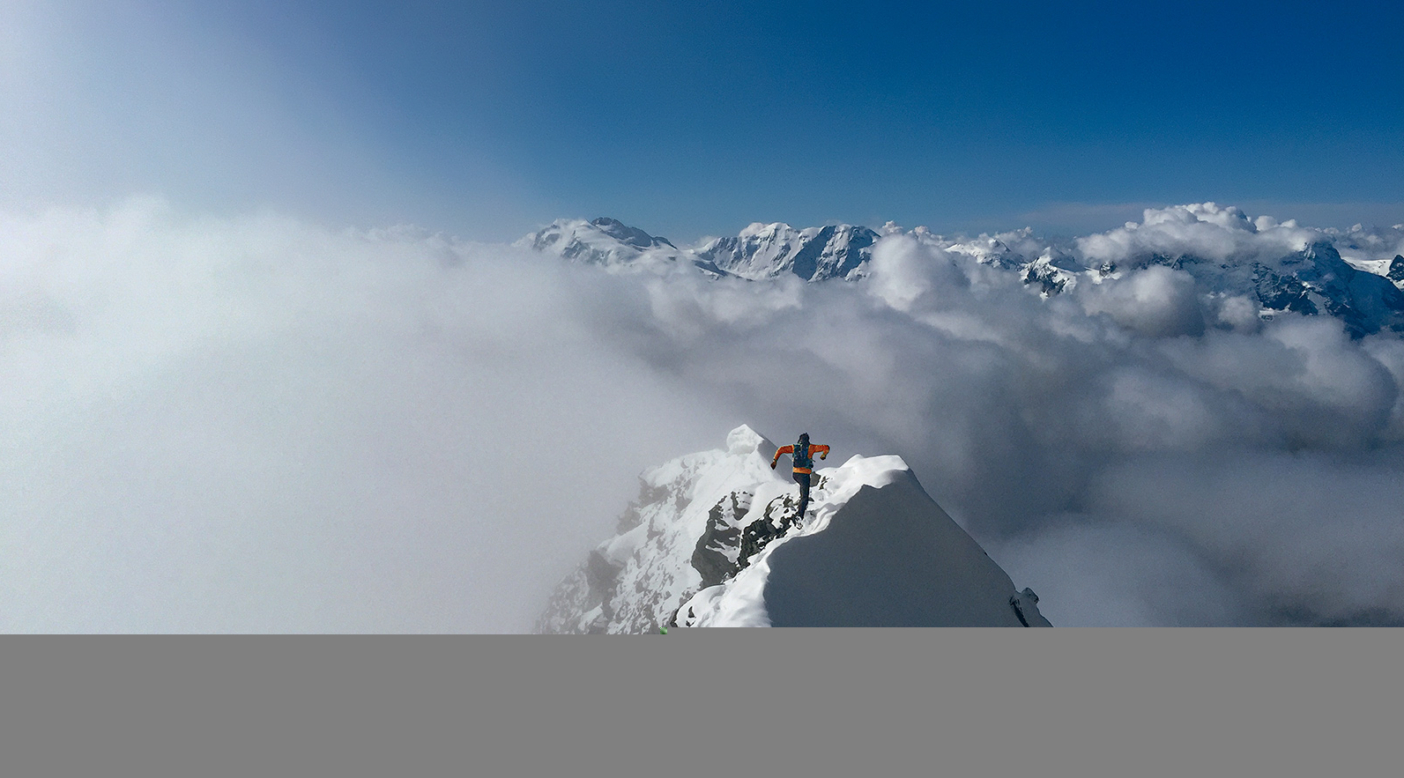 """Mountain runner Kílian  Jornet blazes down the north ridge of Täschhorn in Switzerland. Along  with Steve House and Scott Johnston, he's leading the """"anti-fad"""" training movement for mountain athletes. Photo: Steve House"""