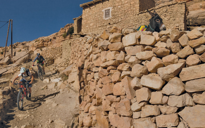 The population of the High Atlas is concentrated in small villages, but it's far more common to see donkeys and other livestock on the paths running through each. Chris Kehmeier and Leilani Bruntz take a well-trod exit near the village of Toulkine. Photo: Leslie Kehmeier