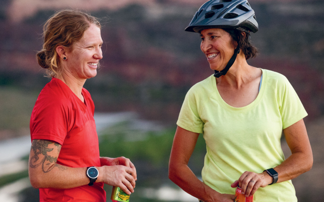 Anne Keller and Jen Zeuner enjoying postride beers at Pizza Point on the Kokopelli Loops. Photo: Carl Zoch