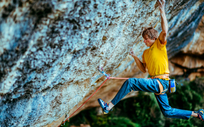 Alex sticks the iconic crux move—a dead point off a right-hand mono to a terrible pinch—on the FA of Perfecto Mundo, one of the hardest routes in the world. Photo: Ken Etzel