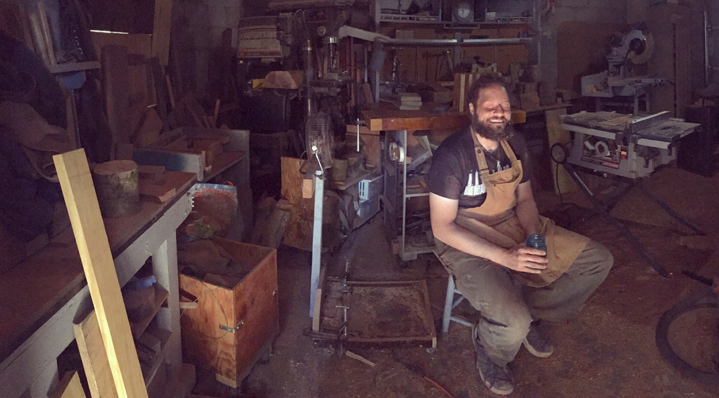 "John ""The Blind Woodsman"" Furniss knows exactly where everything is in his Washougal, Washington, workshop. He also owns a T-shirt that says, ""You will have to speak up. I'm blind."" Photo: Anni Furniss"