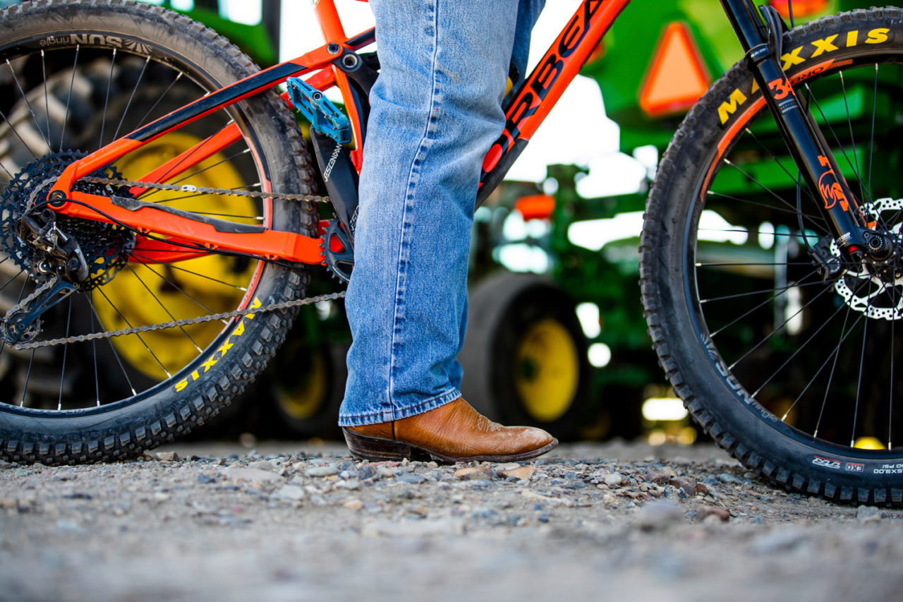 Joe Bernal is a fourth-generation Grand Valley farmer and first-generation mountain biker—although he doesn't do it in boots. Photo: Carl Zoch