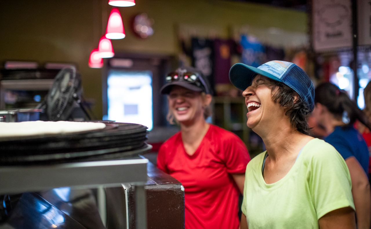 Friday nights at the Hot Tomato are always busy, but even when they're slammed, Jen and Anne keep the vibes high (and the pies comin'). Photo: Carl Zoch