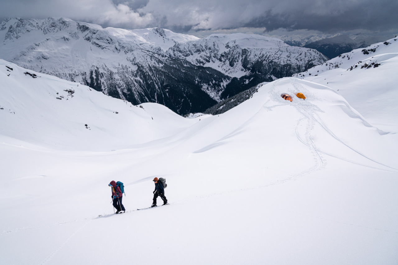 Katrina Van Wijk and Kent Christensen skinning from the second alpine base camp. Touchy snowpack and a full-on winter storm keep the group from skiing lines in the area. Photo: Jasper Gibson