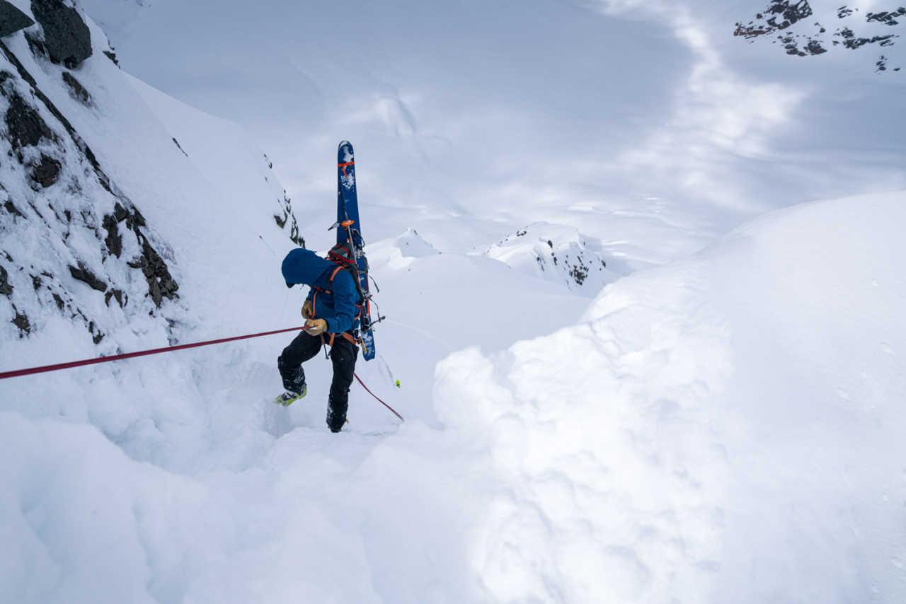 "Mistakes aren't an option when rescue is not guaranteed and your partners are your lifeline. Many miles from anywhere, Erik Johnson rappels into the ""Mount Dang Couloir"" on Mount Scotsimpson with thousands of feet of exposure below. Photo: Jasper Gibson"