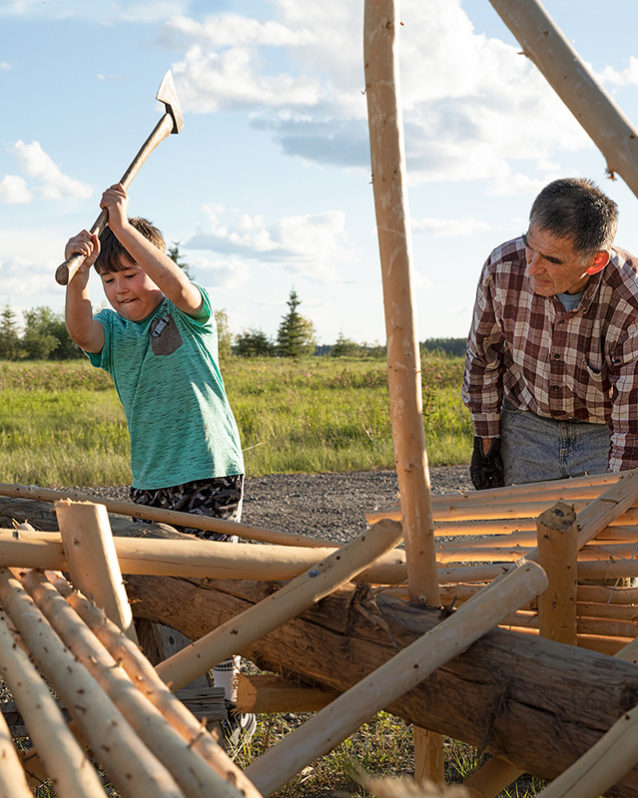 Getting an early education into traditional ways. Nine-year-old Cannon Cadzow helps his grandfather Earl build a fish wheel for salmon season. Photo: Keri Oberly
