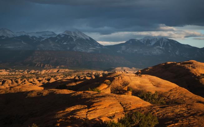 Rawls Moore braves stormy skies on the Slickrock Trail. Photo: Marc O'Brien