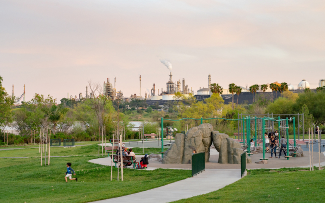 An oil refinery sits behind a park in the neighborhood of Wilmington in Los Angeles, California. There are 91 counties across the US that are building oil refineries or where refineries exist close to more than 6.7 million African Americans and low-income people, according to a study by the NAACP. Photo: Michael Estrada